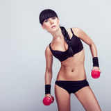 Woman working out with dumbbell Stock Photography