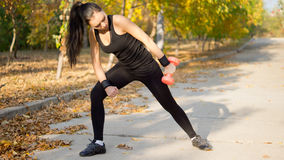 Woman working out with a dumbbell Royalty Free Stock Photos