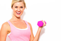Woman working out with dumbbell Royalty Free Stock Photos