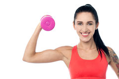 Woman working out with dumbbell Royalty Free Stock Photography