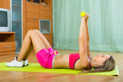 Woman working out with dumbbells Royalty Free Stock Photography