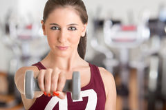 Woman Working Out. With dumbbells at a gym Royalty Free Stock Photo