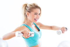Woman working out with dumbbells Royalty Free Stock Photos