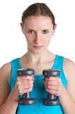 Woman Working Out. With dumbbells at a gym, isolated in a white background Stock Photo