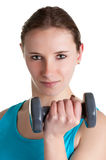 Woman Working Out. With dumbbells at a gym, isolated in a white background Stock Image