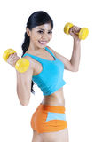 Woman working out with dumbbells Stock Images