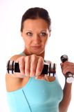 Woman working out with dumbbells Royalty Free Stock Image