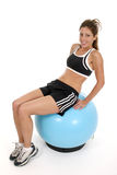 Woman Working Out On Exercise Ball 2 Stock Photos