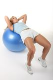 Woman Working Out With Exercise Ball Stock Photo