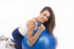 Woman Working Out with an Exercise Ball Royalty Free Stock Photos