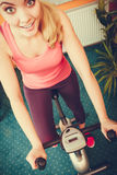 Woman working out on exercise bike. Fitness. Royalty Free Stock Image