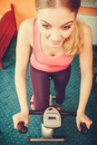 Woman working out on exercise bike. Fitness. Stock Photo