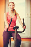 Woman working out on exercise bike. Fitness. Royalty Free Stock Photos