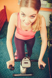 Woman working out on exercise bike. Fitness. Stock Photography