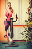 Woman working out on exercise bike. Fitness. Royalty Free Stock Photo