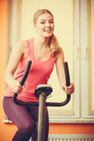 Woman working out on exercise bike. Fitness. Stock Images