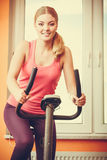 Woman working out on exercise bike. Fitness. Royalty Free Stock Photography