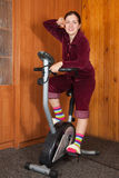 Woman working out on exercycle Stock Photo
