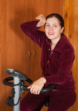 Woman working out on exercycle Royalty Free Stock Photography