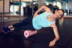 Woman working out with fascia roll Stock Photo