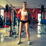 Woman working out in fitness - Active girl Royalty Free Stock Images