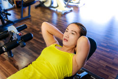 Woman working out in fitness stock image