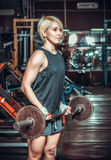 Woman working out in fitness. Club Royalty Free Stock Image