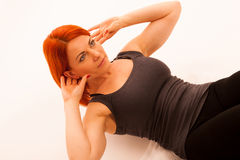 Woman working out in fitness doing situp Royalty Free Stock Images