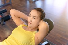 Woman working out in fitness stock photo