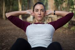 Woman working out in the forest. Close-up of woman working out in the forest Stock Photography