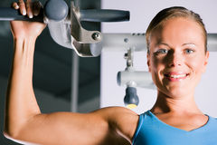 Woman working out in gym Stock Image