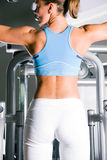 Woman working out in gym Royalty Free Stock Photography
