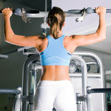 Woman working out in gym Stock Images