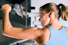 Woman working out in gym Royalty Free Stock Photo