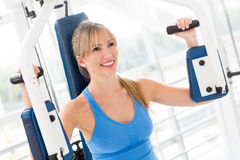 Woman working out at the gym Stock Photos