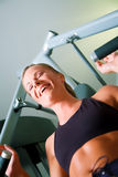 Woman working out in gym Royalty Free Stock Image
