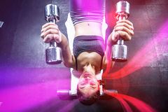 Woman working out in gym Stock Photography