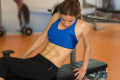 Woman working out in the gym Stock Image