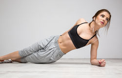 Woman working out at gym Stock Images
