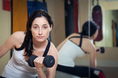 Woman working out in the gym Royalty Free Stock Image
