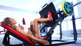 Woman working out at the gym stock video footage
