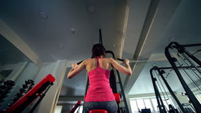 Woman working out at the gym stock footage
