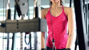 Woman working out at the gym stock video