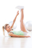 Woman working out. At a health club Royalty Free Stock Photos