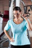 Woman Working Out In Health Club Royalty Free Stock Images