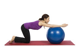 Woman working out her arms with a pilates ball Stock Photography