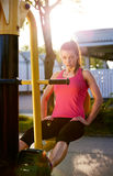Woman working out her lower body outside. Royalty Free Stock Photos