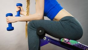 Woman working out at home with dumbbell Royalty Free Stock Image