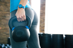 Woman working out with kettle ball. Closeup image of a woman working out with kettle ball Royalty Free Stock Photography
