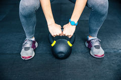 Woman working out with kettle ball Stock Image